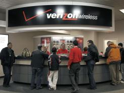 Customers at the counter of the Verizon store in Beachwood, Ohio.