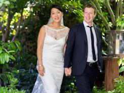 This photo provided by Facebook shows Facebook founder and CEO Mark Zuckerberg and Priscilla Chan at their wedding ceremony in Palo Alto, Calif.
