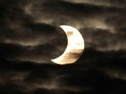 The sun appears sickle-shaped during a partial solar eclipse Jan. 4, 2011, near Muenster, Germany.
