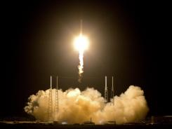 The Falcon 9 SpaceX rocket lifts off from space launch complex 40 at the Cape Canaveral Air Force Station early Tuesday.