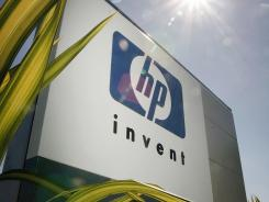 A Hewlett-Packard sign at the main entrance of the company's headquarters in Palo Alto, Calif.