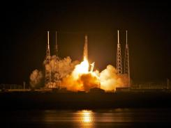 SpaceX's Dragon spacecraft atop rocket Falcon 9 lifts off from the Cape Canaveral Air Force Station in Titusville, Florida.