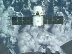 This image provided by NASA-TV shows the SpaceX Dragon commercial cargo craft taken from Canadarm2's video camera as Dragon approaches the International Space Station, Friday, May 25, 2012.