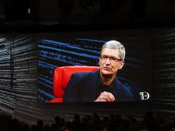 Apple's Tim Cook appears on the big screen during his live in-person interview at the All Things Digital conference.
