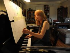 Composer Maria Schneider  has used ArtistShare to raise money from fans to produce  CDs.
