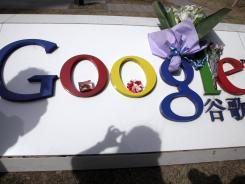 Flowers are placed on the Google logo outside Google China headquarters in Beijing.