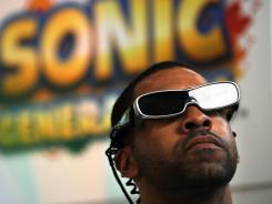 A gamer plays a 3D video game at the 2011 Electronic Entertainment Expo or E3 in Los Angeles, Calif.