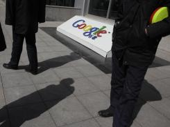 Chinese security guards stand near the Google logo at the company's then head office in Beijing.