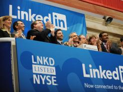 LinkedIn founder Reid Garrett Hoffman (center, with beard) and other executives at the New York Stock Exchange May 19, 2011, for the company's IPO.