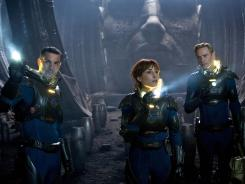 Logan Marshall-Green, left, Noomi Rapace, and Michael Fassbender, right, in a scene from 'Prometheus.'