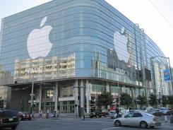 The Apple logo is displayed on the exterior of the Moscone West Center in San Francisco on Saturday. Apple's World Wide Developers Conference kicks off on Monday.