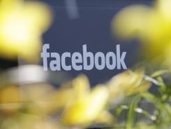 Facebook's headquarters behind flowers in Menlo Park, Calif.