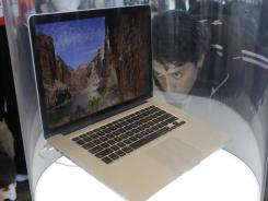 An attendee looks at the new MacBook Pro on display at the Apple Developers Conference in San Francisco.