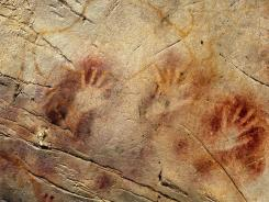 This 'Panel of Hands' in El Castillo Cave in Spain, are older than 40,800 years, making it the oldest known cave art in Europe. They were made by blowing or spitting paint onto the wall.
