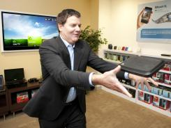 Western Digital executive Scott Vouri with one of the compay's new routers.