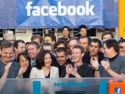 IPO day: CEO Mark Zuckerberg, center right, as the Nasdaq opens on May 18.
