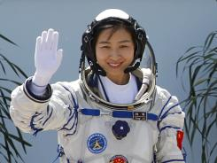 China's first female astronaut Liu Yang, waves during a sending-off ceremony Saturday before the launch of the Shenzhou 9 spacecraft rocket.