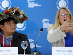 Rebecca Moore (R), Engineering Manager of Google Earth Engine and Earth Outreach, speaks alongside Brazilian Surui tribe Chief Almir (L), during press conference in Rio de Janeiro, Brazil on June 16, 2012.
