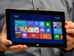 Apple challenger: Microsoft CEO Steve Ballmer shows the company's new tablet late Monday in Los Angeles. Surface has a 10.6-inch-wide display with Gorilla Glass, its own stand and a full-size USB port.