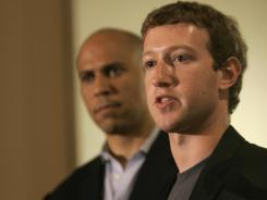 Facebook's Mark Zuckerberg, right, and Newark, N.J., Mayor Cory Booker as Zuckerberg announces a donation to the city's schools in 2010.