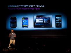 Tim Neil of Research In Motion presents the new keyboard-less Blackberry 10 at an event in Toronto on Thursday.