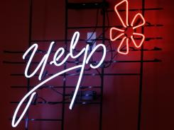 The logo of the online reviews website Yelp in neon on a wall at the company's Manhattan offices.