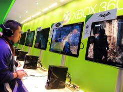 A man samples games on the Xbox 360 at the Consumer Electronics Show in January.