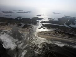 A road is flooded on Hatteras Island, N.C., after Hurricane Irene in 2011. From Cape Hatteras, N.C., to just north of Boston, sea levels are rising faster, according to a study.