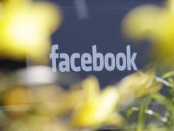 Facebook's headquarters behind flowers in Menlo Park, Calif.