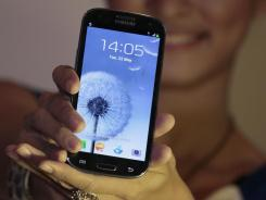 A model displays a Samsung Galaxy S III.