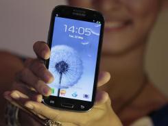 A model displays a Samsung Galaxy S III.