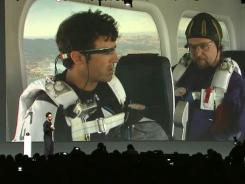 In this screengrab from a livestream of Google's developers conference, Google's Sergey Brin (foreground) kicks off a demo of Google Glass.