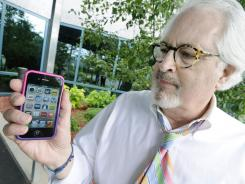 Bob Burns holds his smartphone Wednesday, June 27, 2012 in Minnetonka, Minn.