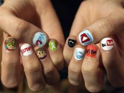 Kimmy Fiorentino, from North Carolina, shows her decorated nails with YouTube video channels at VidCon, the third annual conference and community gathering for online video at the Anaheim Convention Center in Anaheim, Calif.