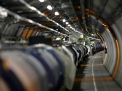 Scientists working at the The Large Hadron Collider, the world's largest atom smasher, may have discovered the existence of &quot;The God Particle.&quot;