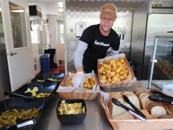 Lunchtime: Ben Laney, manager of the barbecue shack at Facebook, puts out a basket of cornbread.