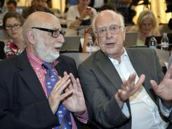Francois Englert, left, and Peter Higgs answer questions about the seminar Wednesday in Meyrin, Switzerland, on the search for the Higgs boson.