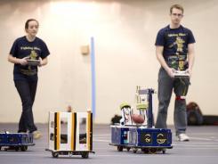 An intercollegiate football game using robots.