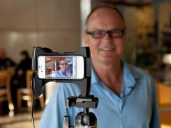 Cris Bennett, the owner of the Good Stuff restaurant in Redondo Beach, interviewed on an iPhone.