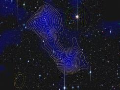 Color image of the galaxy clusters Abell 222 and Abell 223 connected by a dark matter filament. The blue shading and the yellow contours indicate matter density. The image on the sky is about twice as big as the full moon.