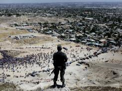 A soldier stands guard over the drug violence-wracked border city of Ciudad Juarez.