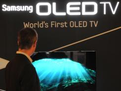 A total of 11 people were charged with stealing technology from Samsung Electronics' new TV that uses organic light-emitting diode (OLED).