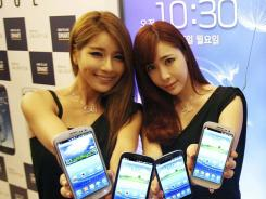 Models display Samsung Electronics' smartphone Galaxy S III.