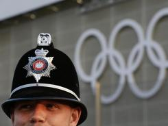 A police officer outside the Aquatics Center at Olympic Park before the 2012 Summer Olympics, July 25, 2012, in London.