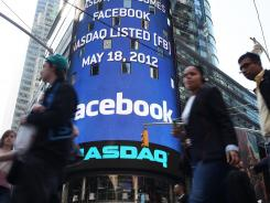 The Nasdaq board in Times Square displays Facebook's logo.