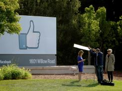 A television crew prepares for a broadcast in front of a 'like' sign outside Facebook headquarters May 18, 2012 in Menlo Park, Calif.