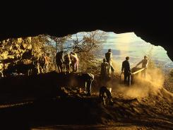 Workers explore South Africa's Border Cave. A study shows modern culture may have emerged in the area much earlier than previously thought.