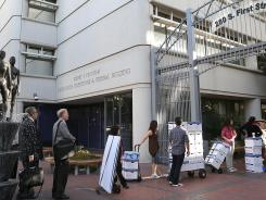 People line up to enter the Robert F. Peckham Federal Courthouse in San Jose for the Apple-Samsung trial earlier this week.