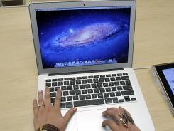 An Apple customer uses an Apple MacBook Air at an Apple store in Palo Alto, Calif.