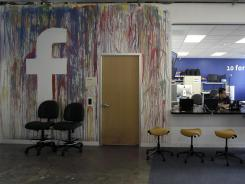 Facebook has lost a number of key employees recently. Here, workers gather at the Facebook office in Menlo Park, Calif.